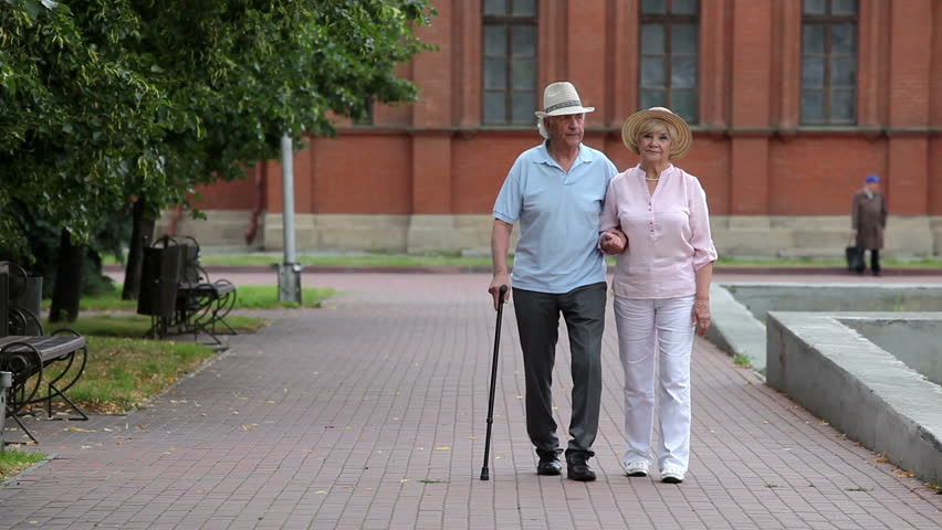 Senior couple enjoying a walk in the park