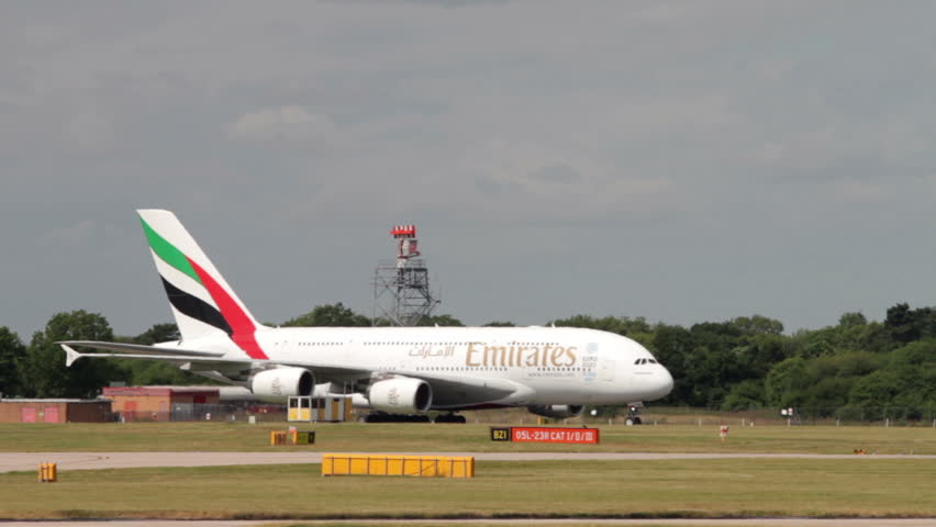 MANCHESTER, LANCASHIRE/ENGLAND - JULY 30: Emirates A380 airbus taxis to the gate after landing on July 30, 2013 in Manchester. Emirates was voted Airline of the Year in 2013.