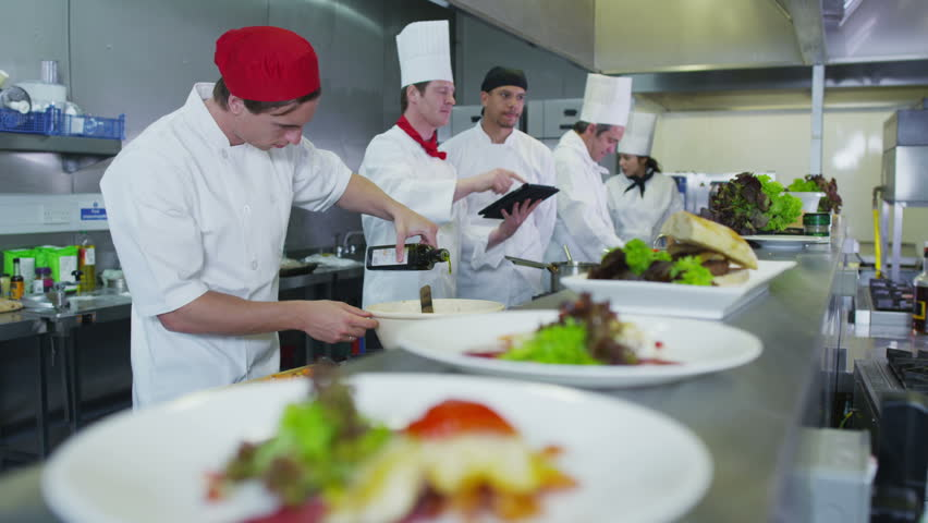 professional chefs in a restaurant or hotel kitchen they are looking