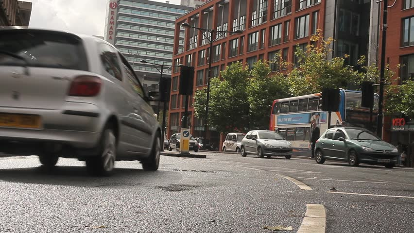 Vehicles traveling through a wet Manchester city centre