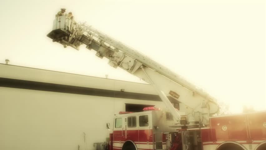 Firemen fighting a fire at a warehouse