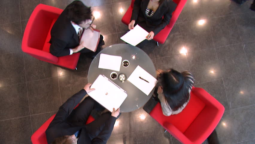 Business meeting over coffee in large financial building. High quality HD video footage