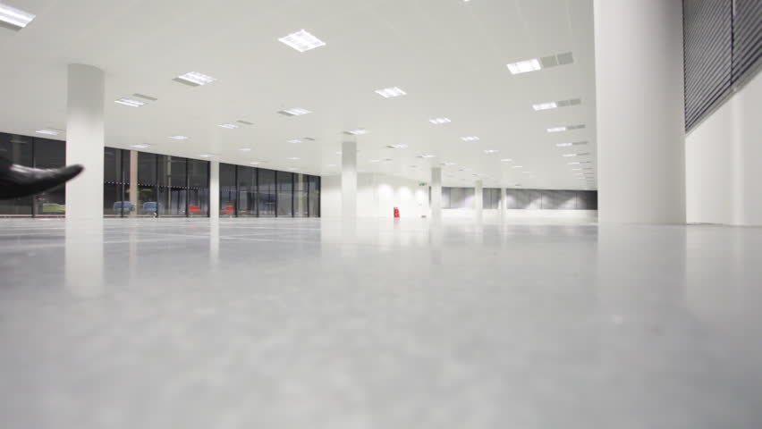 Business executives being shown around a large contemporary office building as potential location for their business. High quality HD video footage
