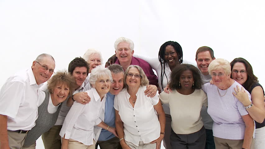 Group Of Senior People Coming Together To Form A Happy