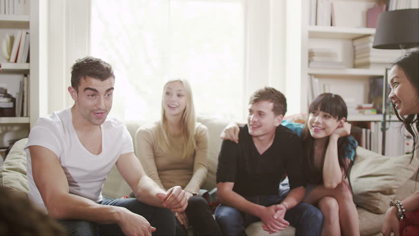 Young people socialising together and having fun. Student house accommodation. Flat share with teenagers or young adults. - HD stock footage clip