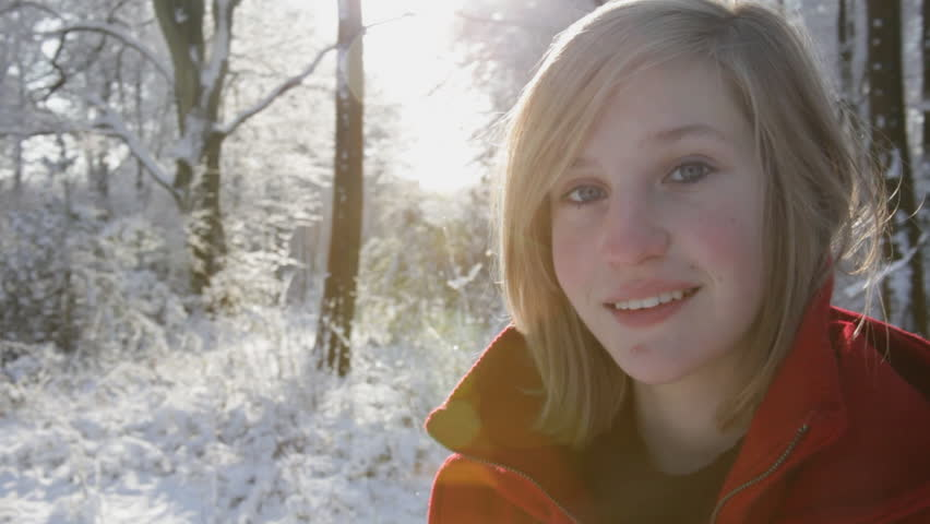 Little Red Riding Hood - Young girl in red coat stands out against a snowy white forest landscape. High quality HD video footage