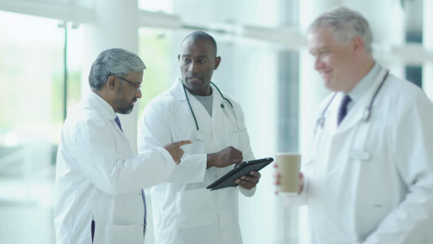 Doctor, nurse, surgeon and patients. Assisting people when life throws unexpected obstacles in your way. A hospital ward or waiting area where patients can by seen by doctors and nursing staff. | Shutterstock HD Video #4503476