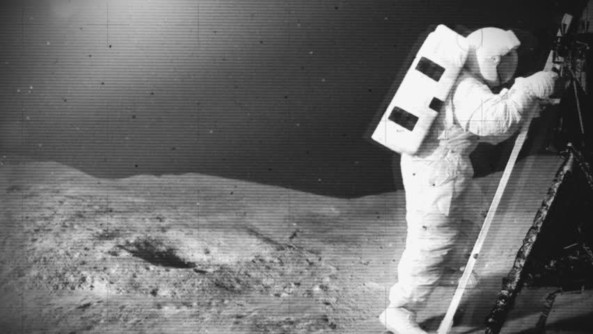 Astronaut moon landing and ground crew back on Earth waiting anxiously. Mock black and white 1960's space footage of the early moon surface landings.