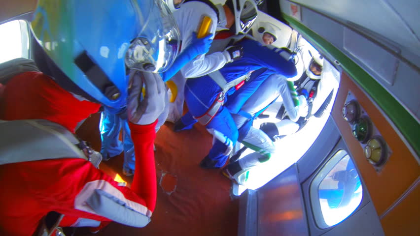 parachutists exit from the aircraft (shooting from inside)