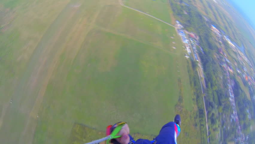 Parachutist against the clear sky