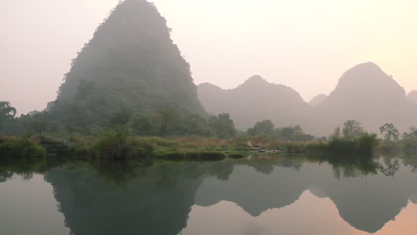 Dragon(Yulong) river Sunrise, shooting on bamboo raft. - Yangshuo Guilin,