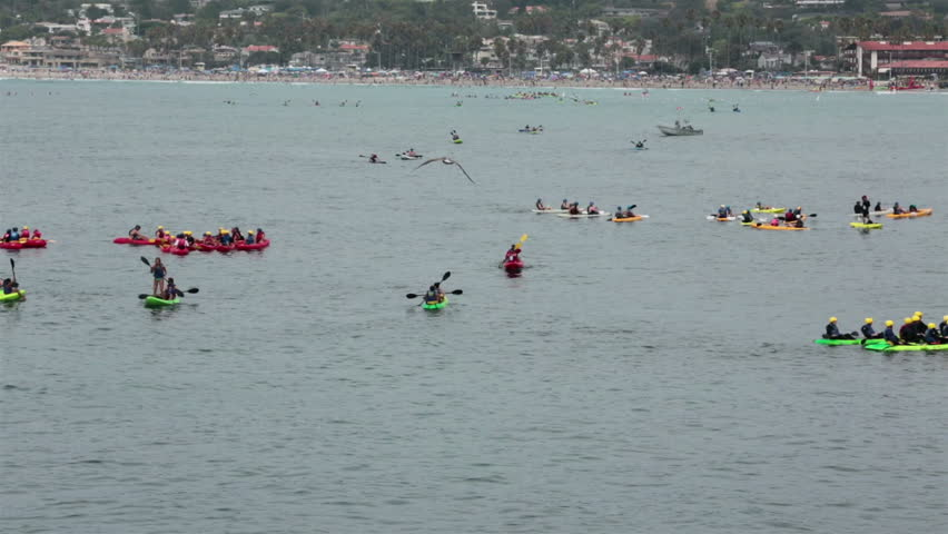 LA JOLLA, CALIFORNIA AUG 2013: End of summer vacation before school tourist at famous beach and cove to enjoy ocean and wildlife. Kayaks in ocean looking for sea lion wildlife. - HD stock footage clip