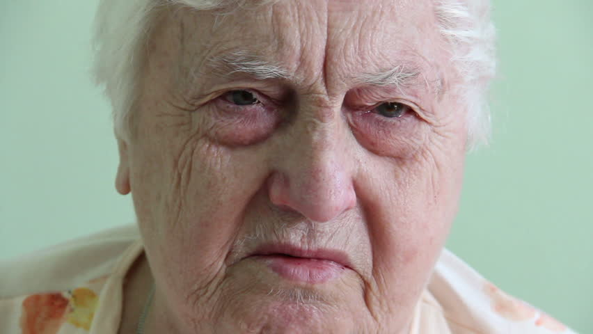Sad face of an 85 years old woman. - HD stock footage clip