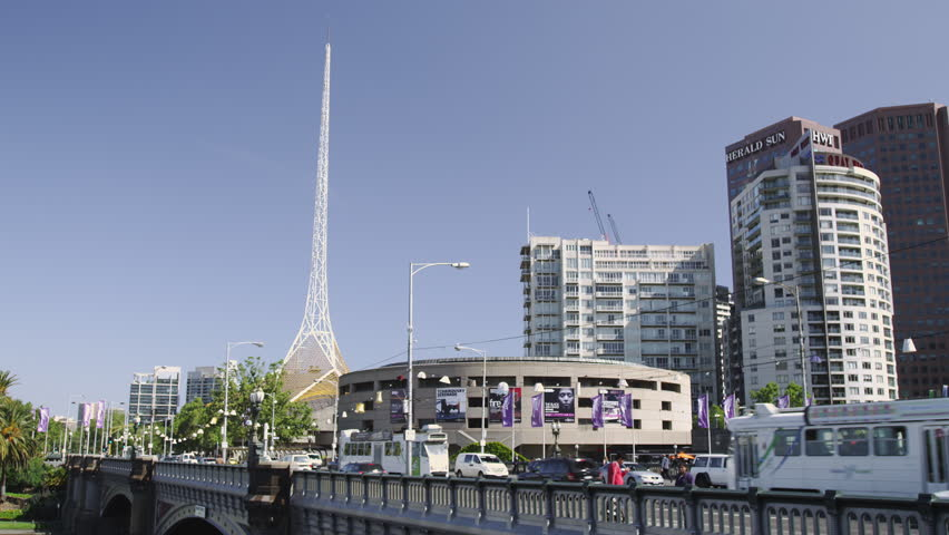 Melbourne - Trams on Princess Bridge with The Arts Center and the Spire