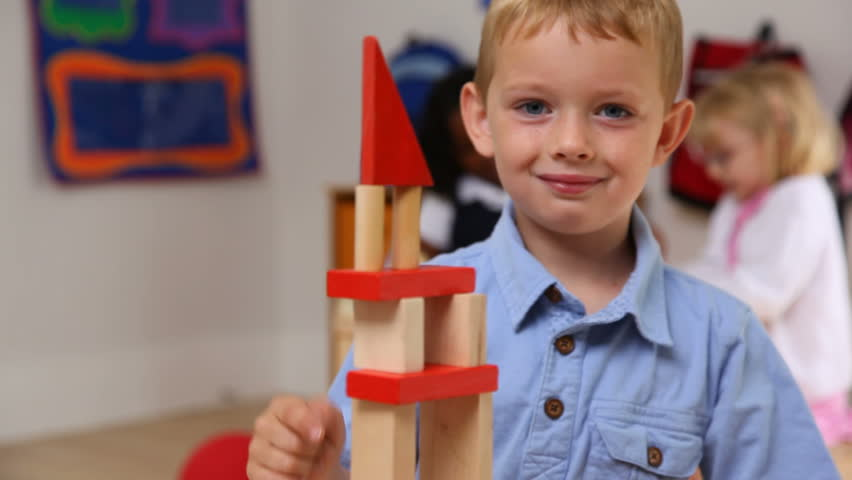 Young boy stacking blocks
