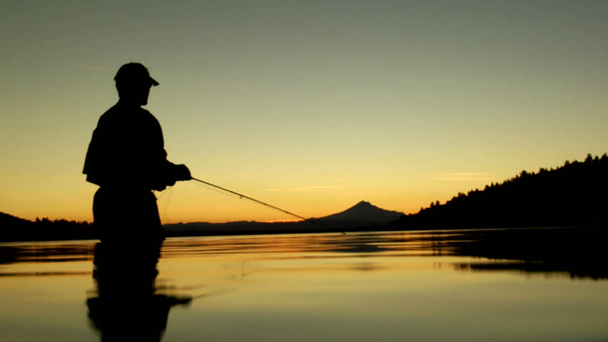 Fly-Fishing at Sunset. Low angle on the water - HD stock video clip