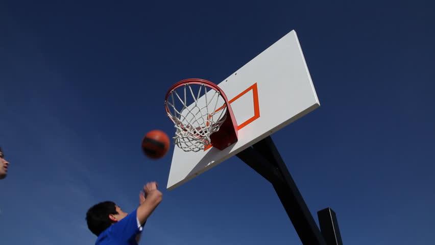 Teens play basketball - HD stock video clip