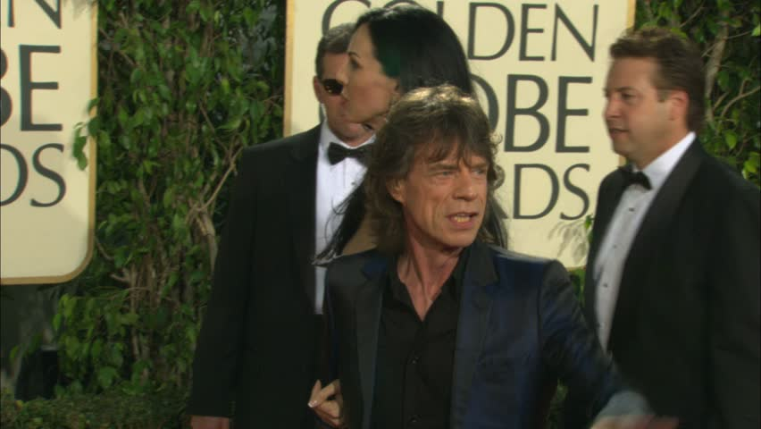 BEVERLY HILLS - January 16, 2005: Mick Jagger and L Wren Scott at the Golden Globe Awards 2005 in the Beverly Hilton Hotel in Beverly Hills January 16, 2005