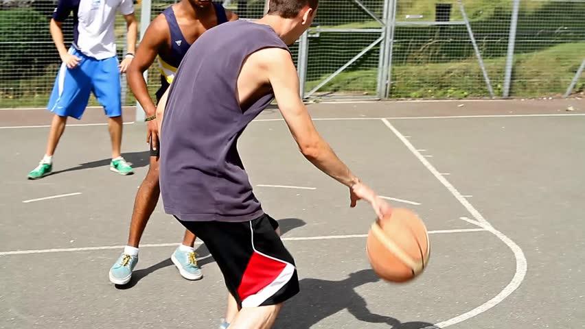 Basketball game with three guys