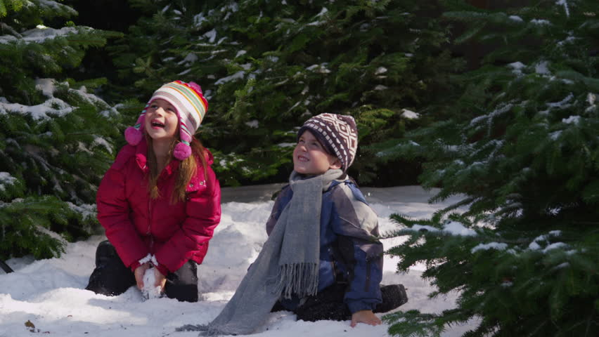Kids throwing snow in winter - HD stock video clip