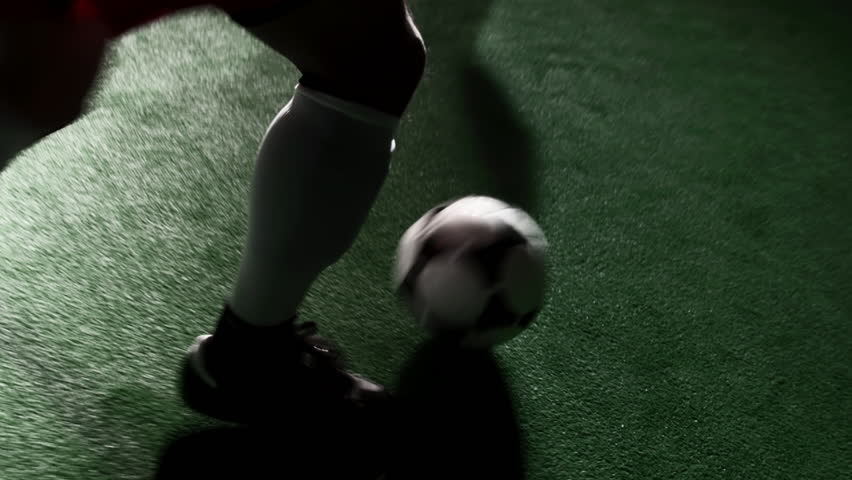 Soccer player dribbles the ball and fakes out defenders. Close up shot - HD stock video clip