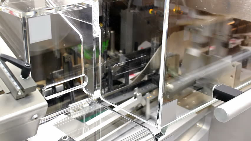 Production of medicines ; machine for packaging tablet in boxes in the factory production of drugs,video clip | Shutterstock HD Video #4611674
