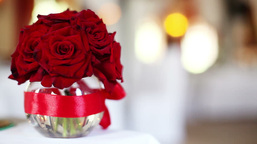 It focus and pan with a bouquet of red roses in a vase | Shutterstock HD Video #4616201
