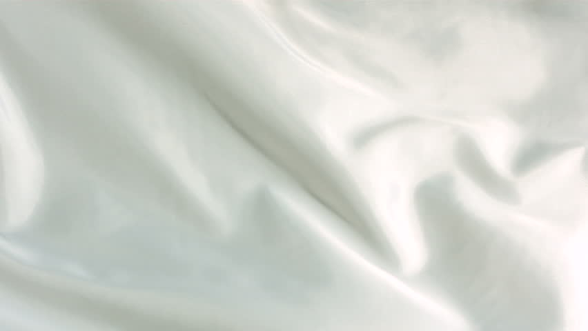 White silk fabric blowing in the wind, abstract background