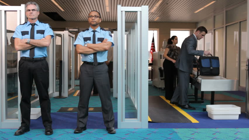 Two airport security guards standing in front of metal detector stock footage video 4629110 - Security guard hd images ...