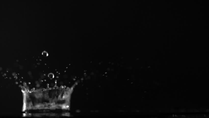 Water drop making splash on black background shooting with high speed camera, phantom flex. - HD stock footage clip