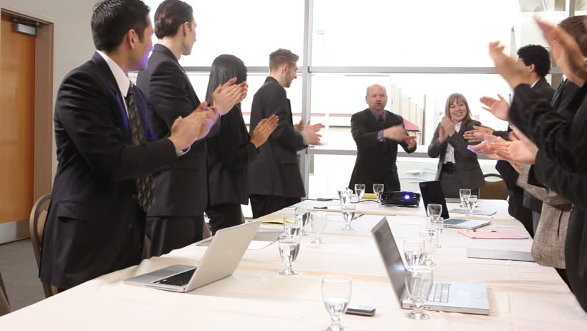 Businesspeople clapping during presentation
