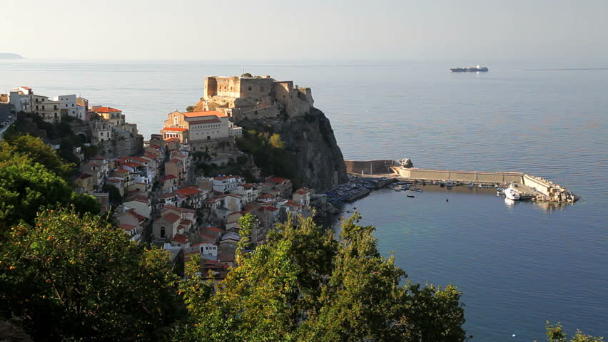 View of the harbor and town with the crumbling ruins of Scilla Castle on a promontory by the sea, Reggio Calabria, Italy - HD stock video clip