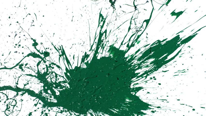 Green paint splattering on white background