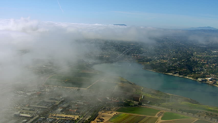 Flying through clouds over Carlsbad California
