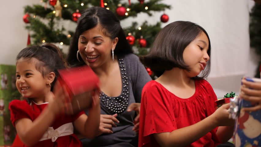 Hispanic family together at Christmas