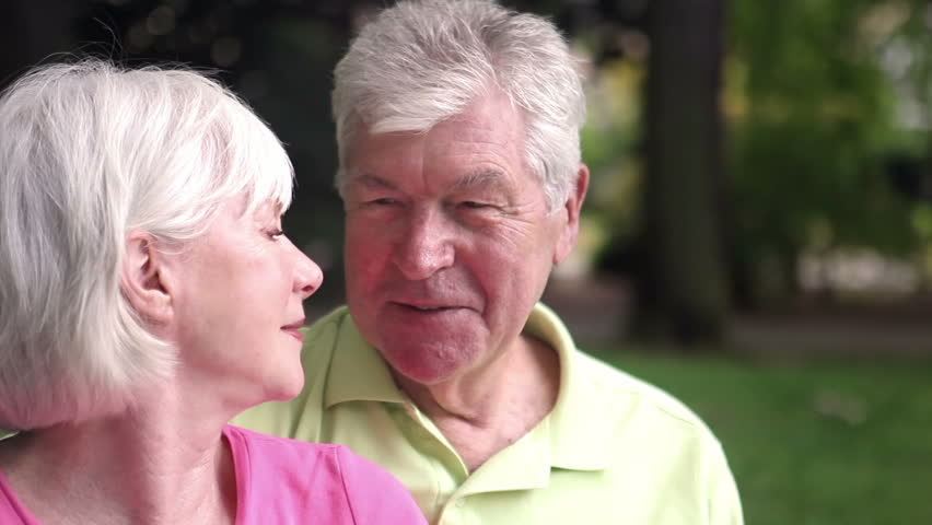 Adorable senior couple kiss each other. Close up shot. - HD stock video clip