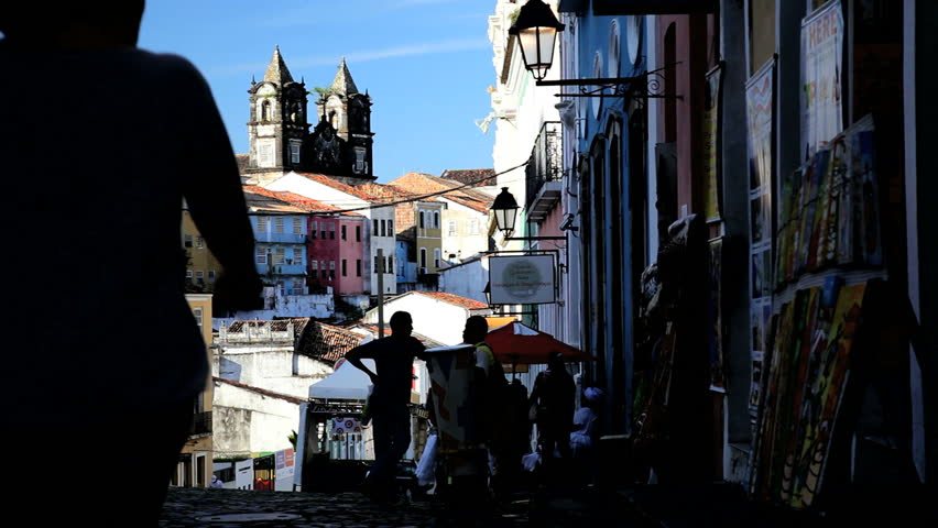 Brazil - January 2012: Street view of tourists walking up a cobblestone street in the historic old town of Pelourinho, Salvador, Brazil in January, 2012
