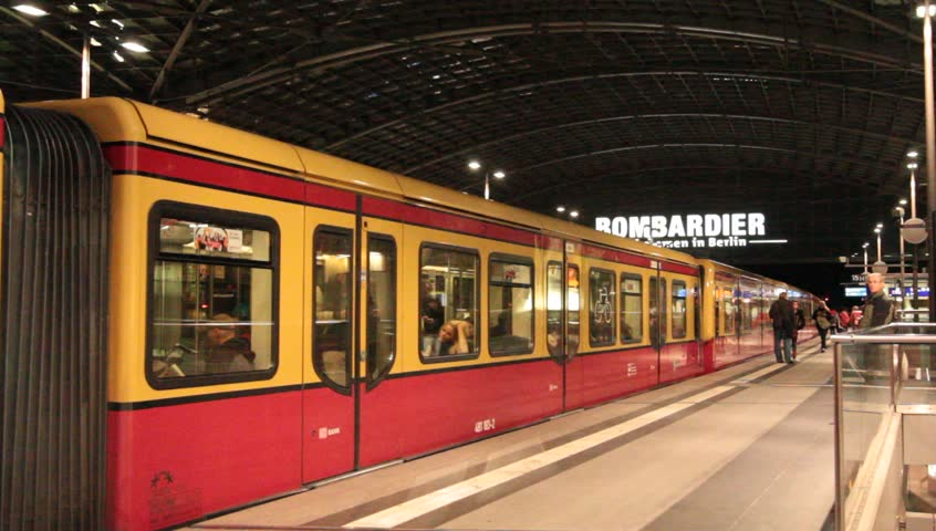 BERLIN - CIRCA 2013: Interior of Berlin Train Station with Yellow and Red Train Pulling Out circa 2013 - HD stock footage clip