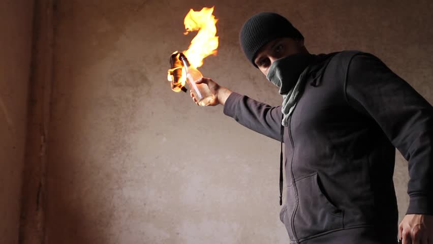 Image result for man throwing molotov cocktail