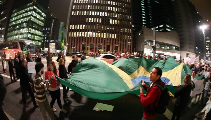 SAO PAULO, BRAZIL – JULY 10: People protest on Avenida Paulista against communism and president Dilma Rousseff, want to reinstate military rule. Sao Paulo, Brazil, July 10, 2013.