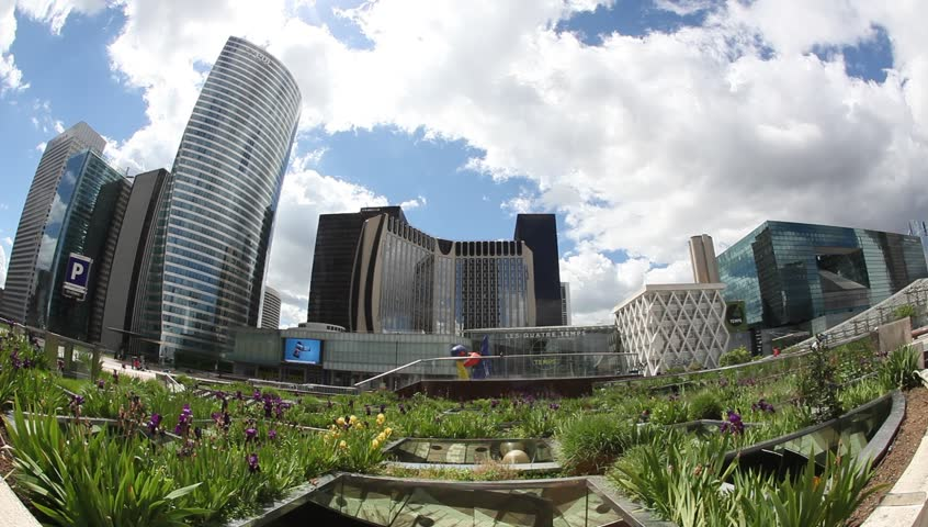 PARIS - MAY 11:  Paris skyline: The Grand Arch and Skyscrapers in the business district of La Defense  in Paris on May 11, 2013   Shutterstock HD Video #4702241