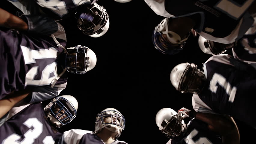 Low angle view looking up into the inside of a huddle
