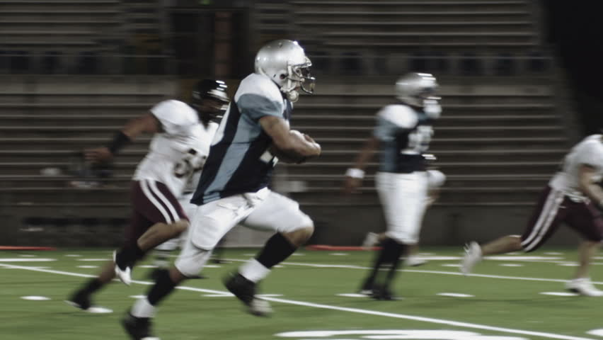 A football player jumps over a tackler - HD stock video clip