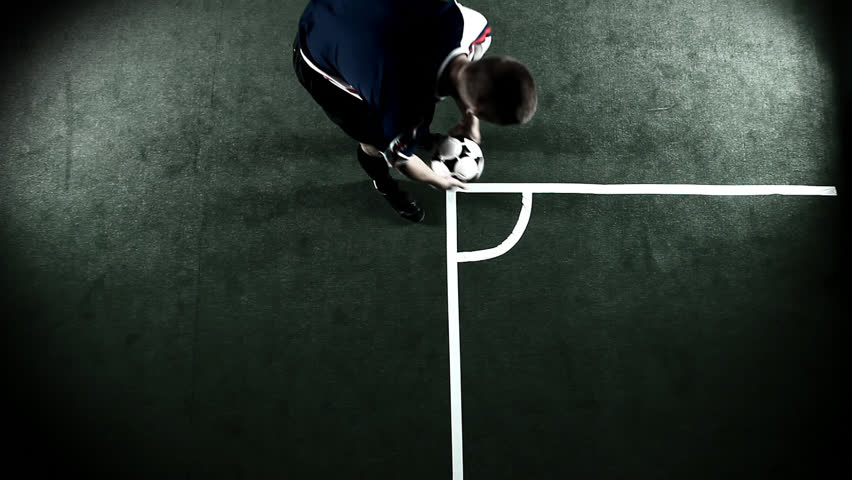 Over head bird's eye view shot of a soccer player running to the ball and giving it a corner kick  - HD stock video clip