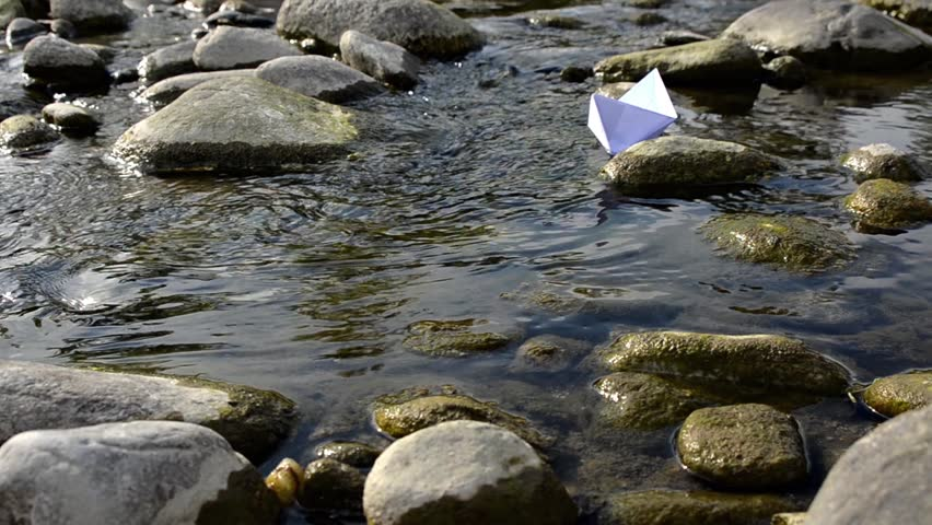 Paper boat floating in a stream  | Shutterstock HD Video #4717298