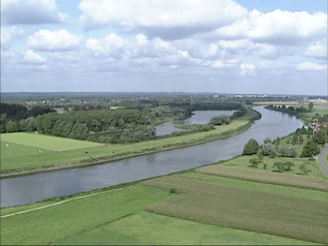 Aerial shot course of river Meuse or Grensmaas at Itteren in in southern Limburg, The Netherlands, prior to the streambed adjustment and channel widening to prevent future flooding. - SD stock footage clip