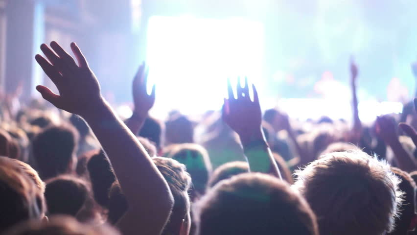 Shot of some cheering fans at a life concert, normal speed, some visible noise due high ISO, soft focus, also slow motion version of this video aviable in my portfolio | Shutterstock HD Video #4749131