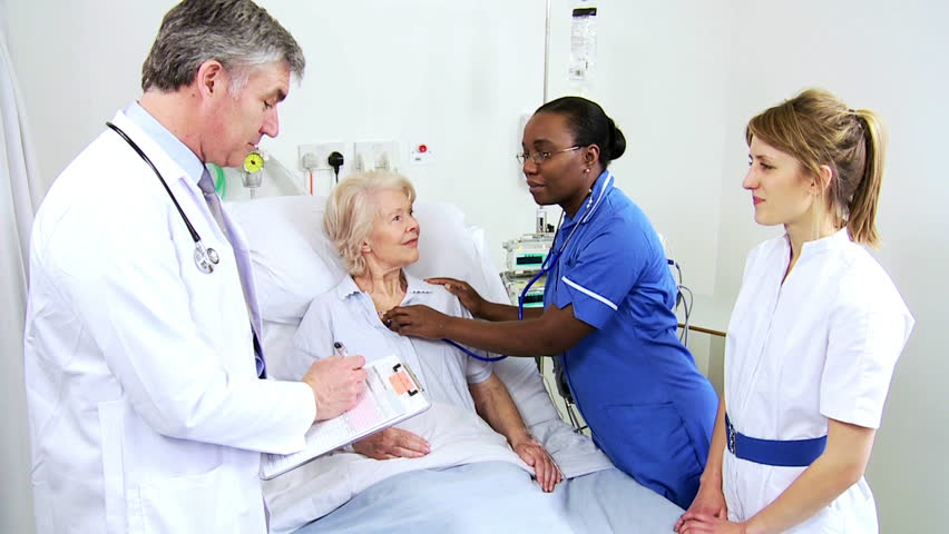 African American nurse using stethoscope to check the vital signs of an older female cardiology patient | Shutterstock HD Video #4761443