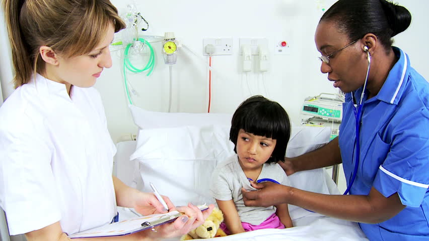 Multi-ethnic nursing staff using stethoscope to monitor heartbeat of a young South Asian pediatrics patient | Shutterstock HD Video #4763531