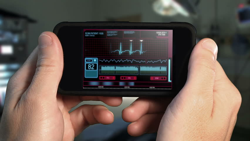 A doctor looks at a futuristic mobile health care device.  With optional luma matte to let you change the background.